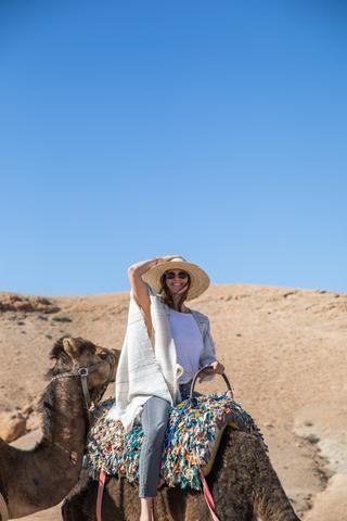 Woman riding a camel