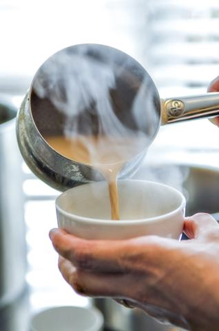 Chai pouring into a cup