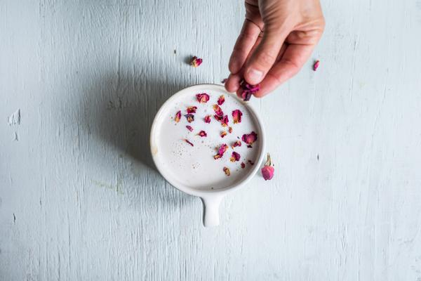 Indian Rose Garden Latte with rose petals sprinkled on top