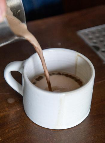 Chocolate chai poured into a mug