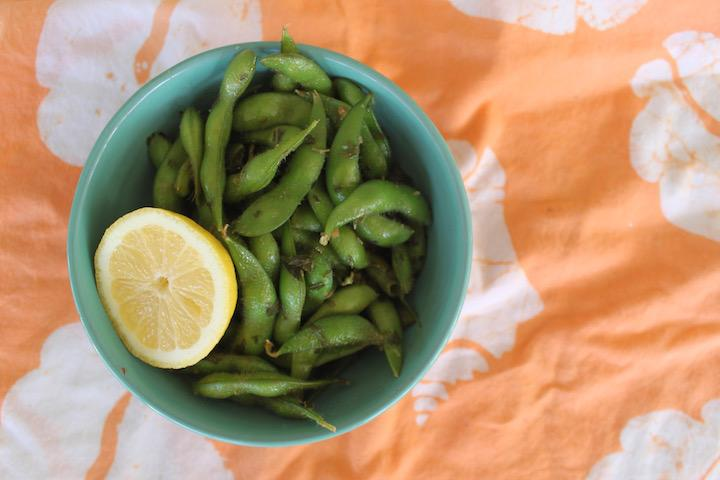 Green Tea Edamame with a slice of lemon