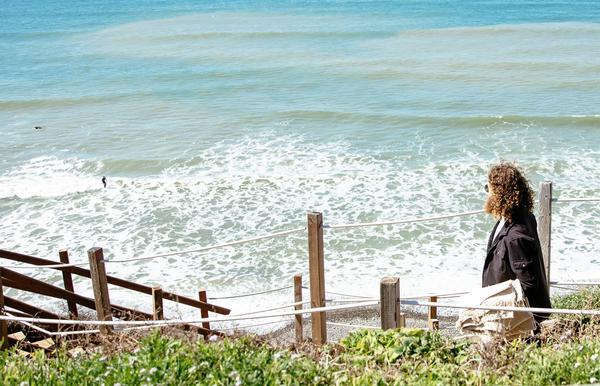 Man walking toward a beach